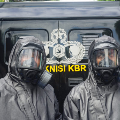 Indonesian police officers wear personal protective equipment amid the COVID-19 outbreak.